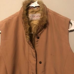 Nice vest wit fur on collar. Little oil stain.